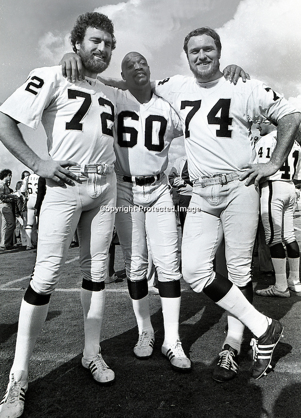 Oakland Raiders linemen, John Matuszak, Otis Sistrunk and Dave Rowe. (1976 photo by Ron Riesterer)