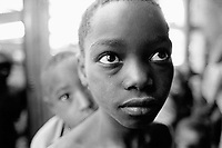 Burundi. Karuzi Province. Myogoro. Young brothers wait to be weighed at the suplementary Feeding Center (SFC) where the non-governmental organization (NGO) Médecins Sans Frontières (MSF)  works. Children are weight and their height measured in order to determine if they are or not malnourished. © 2000 Didier Ruef