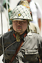 August 15, 2011, Tokyo, Japan - A man wearing a WW2 military uniform prepares to salute in front of the main gate at Yasukuni shrine during commemorations marking the end of WW2. (Photo by Bruce Meyer-Kenny/AFLO) [3692]