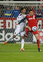 13 April 2011: Los Angeles Galaxy forward Juan Pablo Angel #9 and Toronto FC defender Dan Gargan #8 in action during an MLS game between Los Angeles Galaxy and the Toronto FC at BMO Field in Toronto, Ontario Canada..The game ended in a 0-0 draw.