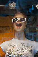 Mannequin with an open mouth wearing sunglasses