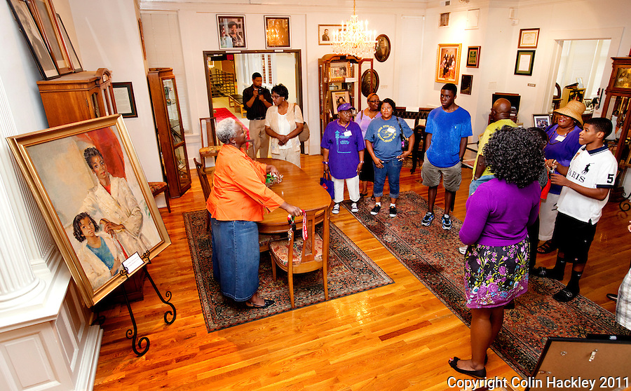 REUNION WELCOME: Murell Dawson, curator of The Black Archives in Tallahassee, greets members of the Robinson family reunion as their tour starts..COLIN HACKLEY PHOTO