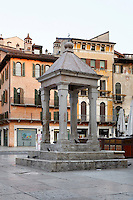 General view of capital, known as the Tribuna or Berlina, Piazza delle Erbe, Verona, Italy. Built before the 13th century, the Praetorians sat under it for the swearing in ceremony, when they took office. The Piazza delle Erbe (Square of Herbs) stands on the old Roman Forum, and remains the centre of city life. Picture by Manuel Cohen.