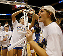 UCLA's Meg Norton cuts down the game net with her teammates after defeating Illinois in the 2011 NCAA Division I Women's Volleyball National Championship Match at the Alamodome on Saturday, Dec. 17, 2011. UCLA won in four sets, 25-23, 23-25, 26-24, 25-16.