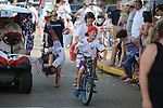 Wyatt McCool and Lidden Riddell ride in the 4th of July parade in Oxford, Miss. on Wednesday, July 4, 2012.