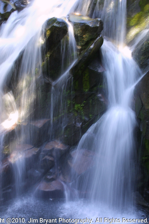 Waterfall on Mount Rainier.  Mt. Rainier is heavily glaciated, dormant volcano surrounded by alpine parks. The 14,411 foot volcano which covers 228,480 acres was designated a National Park in 1899. Jim Bryant Photo. &copy;2010. All Rights Reserved.