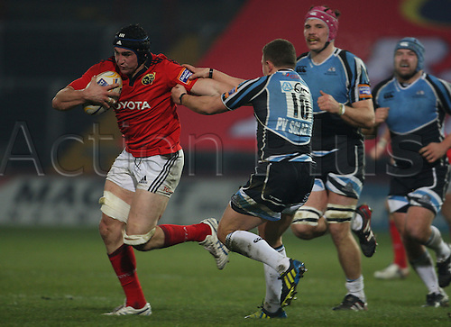 01.12.2012 Limerick, Ireland. Tommy O'Donnell in action against Duncan Weir, during the RaboDirect PRO12 game between Munster and Glasgow Warriors from Thomond Park.