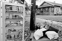USA. Louisiana. New Orleans. Orleans Parish. St Bernard Avenue. Aftermath of hurricane Katrina. The houses (villas, detached or personal houses) were all flooded and the inhabitants have left the town. The belongings have been destroyed by the water or the electricity cuts and have to be thrown away, like a fridge full of food. Household refuses. Family  waste. © 2005 Didier Ruef