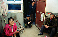 China. Province of Shaanxi. Village Shifeng. A portrait of the Yao Jianmin's family whose boy was kidnapped on may 12 2002, sold to a family in the village of Nan Laoguanzui in Henan province. The police found him and brought him back to his family on march 4 2004. The family has then decided, because of the poverty they live in, to resell his child to the family which already bought him (from the thieves) and with whom he lived happy for almost two years. © 2004 Didier Ruef