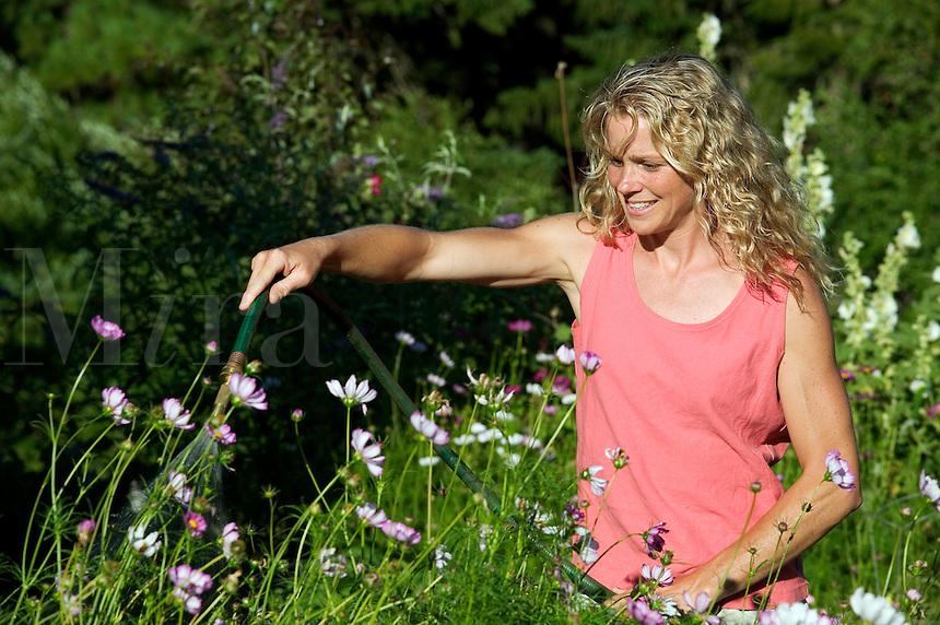 A Woman Gardening Mira Images