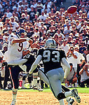Oakland Raiders vs. Chicago Bears at Oakland Alameda County Coliseum Sunday, September 26, 1999.  Raiders bet Bears  24-17.  Oakland Raiders defensive back Darrien Gordon (23) hits Chicago Bears quarterback Shane Matthews (9).