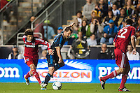 Wells Thompson (15) of the Chicago Fire fouls Daniel Cruz (44) of the Philadelphia Union earning his second yellow card of the match. The Philadelphia Union defeated the Chicago Fire 1-0 during a Major League Soccer (MLS) match at PPL Park in Chester, PA, on May 18, 2013.