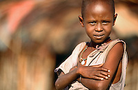 Young Samburu girl in the village Nuguroro. They are one of the poorest groups in the Samburu National Park area. They have comparatively few real assets as measured in cattle and goats, many children, and they see very few tourist visitors.