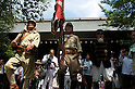 August 15, 2011, Tokyo, Japan - Men wearing Japanese military uniforms march out of the main shrine during commemorations marking the end of WW2. (Photo by Bruce Meyer-Kenny/AFLO) [3692]
