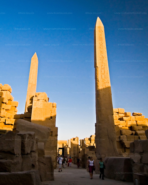 Luxor, Egypt -- Queen (pharaoh) Hatshepsut had two massive obelisks erected near the main temple of Amun at Karnak.  Subsequent pharaohs sought to remove her influence but could not deface stellae honoring Amun, so they built walls to hide the obelisks from view and worship.  Karnak was built over many generations of Egyptian pharaoh, as each successive king added pieces to this temple honoring the most significant god of the ancient Egyptian pantheon, the god Amun (later, Amon-Ra), the sun god. © Rick Collier / RickCollier.com