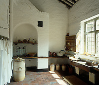 This  rustic kitchen retains its original period details,  fittings and furniture and illustrates the working conditions in the 18th and 19th centuries