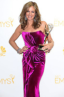 LOS ANGELES, CA, USA - AUGUST 25: Actress Allison Janney, winner of the Outstanding Supporting Actress in a Comedy Series Award for 'Mom' poses in the press room at the 66th Annual Primetime Emmy Awards held at Nokia Theatre L.A. Live on August 25, 2014 in Los Angeles, California, United States. (Photo by Celebrity Monitor)