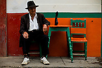 A resident rests in the town of Jardin in Antioquia August 1, 2012. Photo by Eduardo Munoz Alvarez / VIEW.