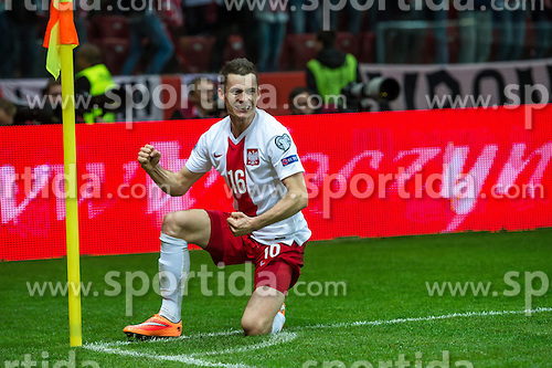14.10.2014, Nationalstadium, Warsaw, POL, UEFA Euro Qualifikation, Polen vs Schottland, Gruppe D, im Bild Krzysztof Maczynski poland #16 radosc po gol bramka // Krzysztof Maczynski poland #16 joy after goal celebrates after scoring goal // during the UEFA EURO 2016 Qualifier group D match between Poland and Scotland at the Nationalstadium in Warsaw, Poland on 2014/10/14. EXPA Pictures &copy; 2014, PhotoCredit: EXPA/ Newspix/ Sebastian Borowski<br /> <br /> *****ATTENTION - for AUT, SLO, CRO, SRB, BIH, MAZ, TUR, SUI, SWE only*****