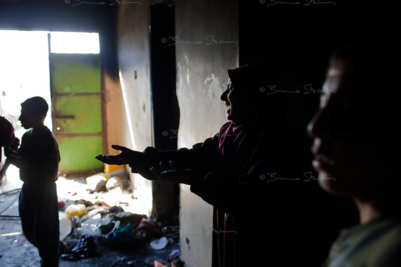 Attatra, Gaza Strip, Jan 21 2009.Fatma Al Attar, 39..Twenty-six members of the Al Attar family have to live in their burned down home, without windows, furniture, beds or clothes...