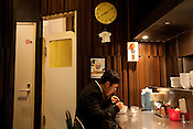 Customer in Bassa Nova ramen restaurant in Shindaita district, in Tokyo, Japan, Wednesday 28th April 2010.