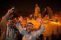 Egyptian protesters react with with anger and disbelief  February 10, 2011 after watching a televised speech by President Hosni Mubarak on a screen in Tahrir Square  in Cairo, Egypt. Mubarak conceded only some powers to Vice President Omar Suleiman yet refused to concede the title of President and will remain in charge of transition towards democratic reforms, upsetting the crowd which had expected a full resignation. .Slug: Egypt.Credit: Scott Nelson for the New York Times