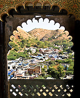 Old palace overlooking town nestled in the Rajasthani hills. (Photo by Matt Considine - Images of Asia Collection)