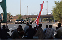 U.S. Army soldiers in humvees keep a watchful eye over an October 07, 2003 Shia protest against the detention of local Shia Imam Sheik Mo'ayed al-Khezragi by U.S. military  at the al-Baya'a mosque in Baghdad, Iraq.