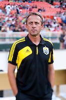 Head coach Robert Warzycha of the Columbus Crew watches his team before the game at RFK Stadium in Washington, DC.  D.C. United defeated the Columbus Crew, 1-0.
