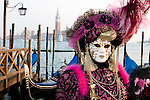 People dressed for the Carnival in Venice Italy.  Carnival or Carnevale in Italian, is a celebration for the 10 days before Lent, the Christian time of fasting before Easter Sunday.  People come from all over the globe to participate in the celebration that is centered in Piazza San Marco.  They dress in elaborate costumes with masks.  There are performaces of the Commedia dell'arte as well as parades throughout the city.