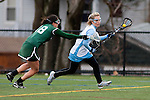 20110405 - Medford/Somerville, Mass. -  Tufts midfielder Mary Kate Gorman (E13) tries to break past a Babson defender at Bello Field on April 5, 2011. (Kelvin Ma/Tufts University)