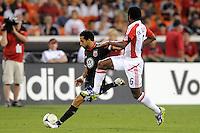 D.C. United forward Dwayne de Rosario (7) goes against Toronto FC midfielder Julian de Guzman (6)  D.C. United defeated Toronto FC 3-1 at RFK Stadium, Saturday May 19, 2012.