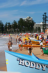 Surf carnival by a sunny day in Manly, North Steyne.