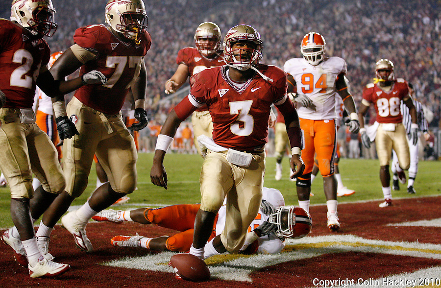 TALLAHASSEE, FL 11/13/10-FSU-CLEMSON FB10 CH-Florida State's EJ Manuel, center celebrates his touchdown as Clemson's Corico Hawkins lays on the ground after failing to keep Manuel from scoring in the fourth quarter Saturday at Doak Campbell Stadium in Tallahassee. The Seminoles beat the Tigers 16-13..COLIN HACKLEY PHOTO