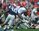 Georgia running back Isaiah Crowell (1) runs past Ole Miss' C.J. Johnson (10) at Vaught-Hemingway Stadium in Oxford, Miss. on Saturday, September 24, 2011. Georgia won 27-13.