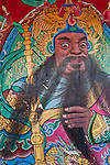 Door God General Wei Chigong is dark skinned, has bulgy eyes and holds a bian(鞭-- segmented iron weapon). Kaiji Lingyou Temple, Tainan City, Taiwan