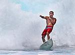 A surfer catches a wave at Ehukai Beach (Banzai Pipeline) on the Northshore of Oahu, Hawaii.