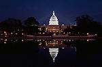 The US Capitol at night reflected in the pool at the foot of capitol Hill., Washington DC ; Congress; Government.