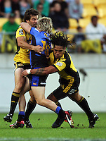 Conrad Smith and Ma'a Nonu tackle Force fullback Drew Mitchell during the Super 14 rugby match between the Hurricanes and Western Force at Westpac Stadium, Wellington, New Zealand on Saturday, 20 February 2010. Photo: Dave Lintott / lintottphoto.co.nz