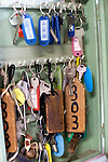 """Keys for boats and a variety of other vehicles hang in a key box at the headquarters of the Yasuda family's """"yakata-bune"""" pleasure boat business in Tokyo, Japan on 31 August  2010. .Photographer: Robert Gilhooly"""