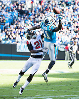 The Carolina Panthers defeated the Atlanta Falcons 34-10 in an inter-division rivalry played in Charlotte, NC at Bank of America Stadium.  Carolina Panthers wide receiver Brandon LaFell (11) stretches for a pass against defender Atlanta Falcons cornerback Desmond Trufant (21)