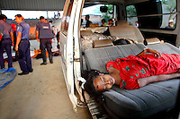 A dead female worker lies on a car seat outside the Rana Plaza complex while rescue workers look for other survivors. ..The 8 storey building, which housed a number of garment factories employing over 3,000 workers, collapsed on 24 April 2013. By 29 April, at least 380 were known to have died while hundreds remained missing. Workers who were worried about going to work in the building when they noticed cracks in the walls were told not to worry by the building's owner, Mohammed Sohel Rana, who is a member of the ruling Awami League's youth front. He fled his home and tried to escape to neighbouring India after the building collapsed but was caught by police and brought back to Dhaka. Some of the factories working in the Rana Plaza building produce cheap clothes for various European retailers including Primark in the UK and Mango, a Spanish label. . /Felix Features