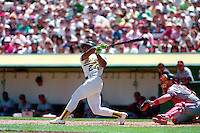 OAKLAND, CA - Rickey Henderson of the Oakland Athletics bats during a game against the California Angels at the Oakland Coliseum in Oakland, California in 1990. Photo by Brad Mangin