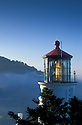Heceta Head Lighthouse with early morning fog along the Oregon coast.