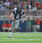 Ole Miss' Zack Stoudt (8) runs against Georgia at Vaught-Hemingway Stadium in Oxford, Miss. on Saturday, September 24, 2011. Georgia won 27-13.