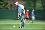 Golfer Vance Veazey makes a birdie putt on the 2nd hole at the PGA FedEx St. Jude Classic at TPC Southwind in Memphis, Tenn. on Thursday, June 9, 2011.