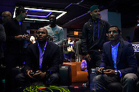 "Red Bull player Tim Cahill ( R) enjoys an electronic game while they attend an event organized by MLB and EA Sports for launching the last soccer game named ""FIFA Soccer 13"" in New York . Photo by Eduardo Munoz Alvarez / VIEW."