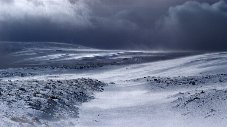 Grey stormy sky over moorland in England