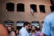 A fan finds a better view for the set by Ben Sollee during The Rosebuds & Friends day party during the Hopscotch Music Festival, Saturday, Sept. 10, 2011.
