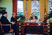 United States President George H.W. Bush, right, meets White House Chief of Staff John Sununu, left, and U.S. Secretary of State James A. Baker, III for a briefing on the upcoming Malta Summit with Soviet President Mikhail Gorbachev (not pictured) in the Oval Office of the White House in Washington, D.C. on November 28, 1889..Credit: Arnie Sachs / CNP